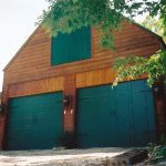 Green garage farm doors with foliage