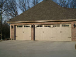 Two different sized white garage doors