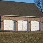 Three lovely white residential garage doors