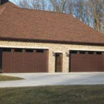 Two beautiful brown garage doors