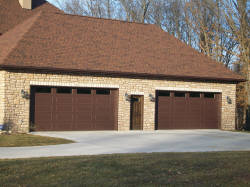 Two beautiful brown garage doors