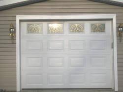 A standard, white residential garage door