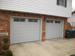 Grey residential garage doors with small windows
