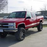 Front view of red pickup truck at KB Tire & Auto