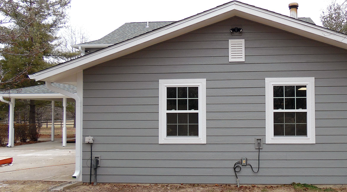 Outside view of grey siding by TrueSon Exteriors