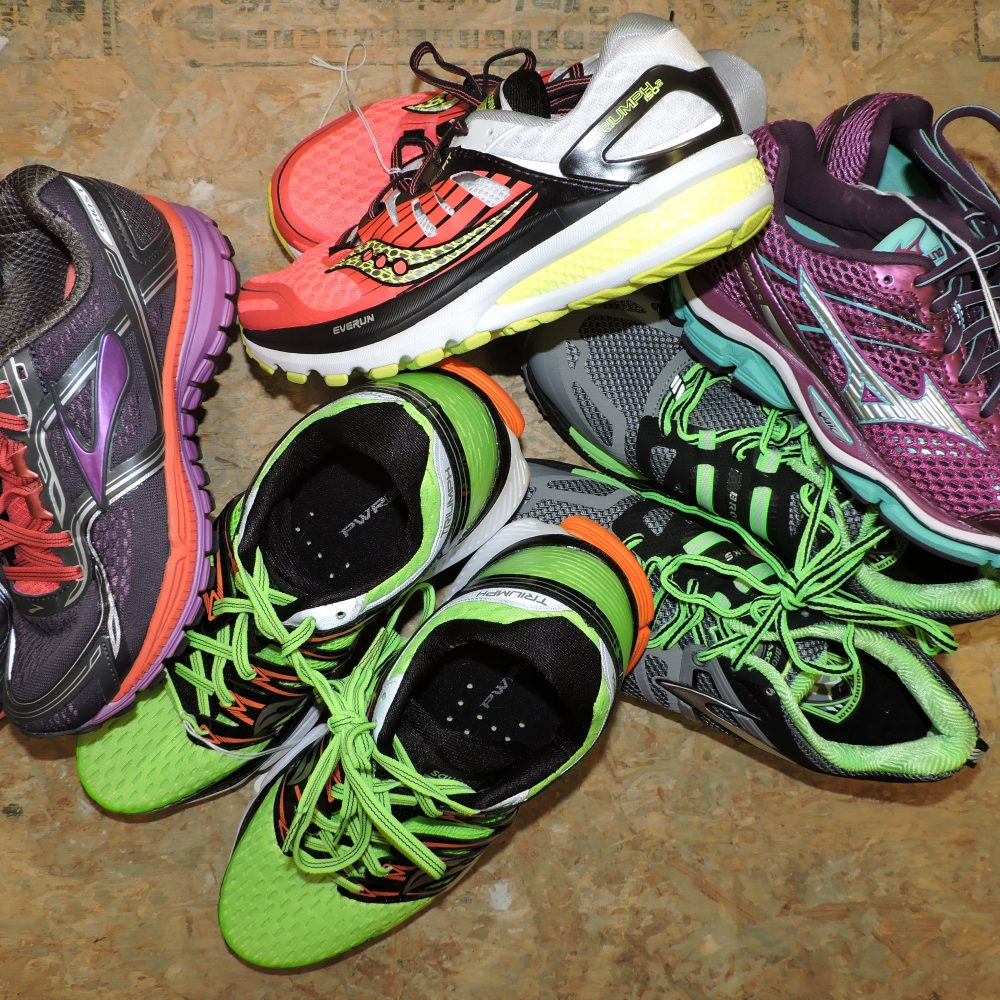 New running shoes in a cluster on the floor