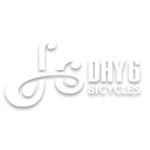 Day 6 Bicycles brand logo in white