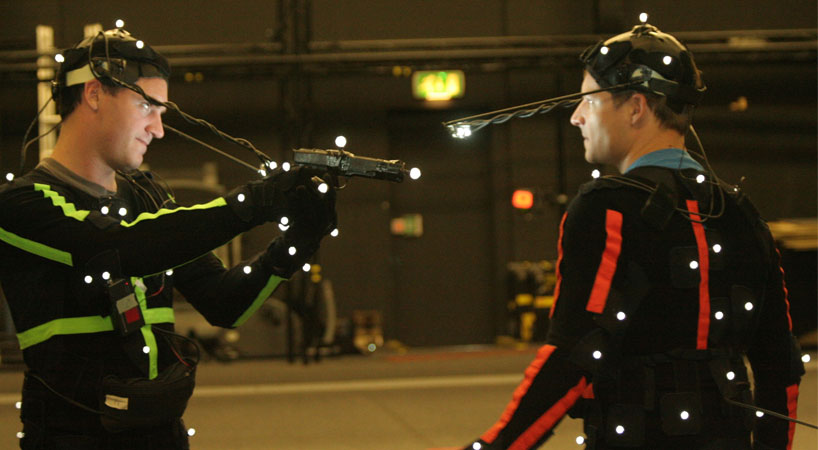 Black suits and white balls for traditional motion capture