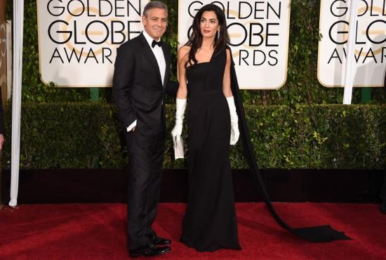 George Clooney e Amal, que atraiu todas as atenções num longo Dior Couture e luvas brancas