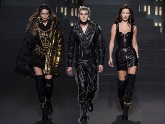 O trio Hadid abalou no desfile da colab Moschino [TV] H&M - Gigi, que abriu o show, Anwar e Bella! Vem ver mais na galeria!