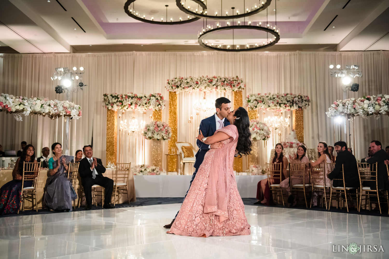Wedding Reception Hilton Waterfront Huntington Beach Wedding first kiss