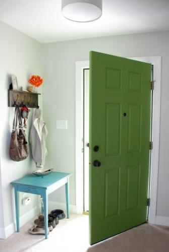 green painted front door inside interior