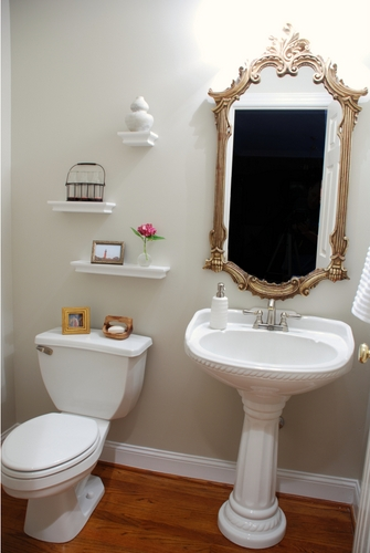 Neutral Powder Room Makeover - pedestal sink and ornate gold mirror | www.livelygreendoor.com