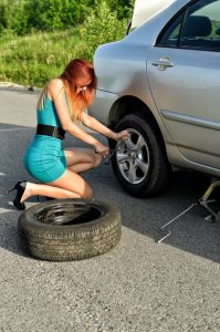 Woman changing a tire