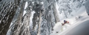 Skiing in Whistler through trees