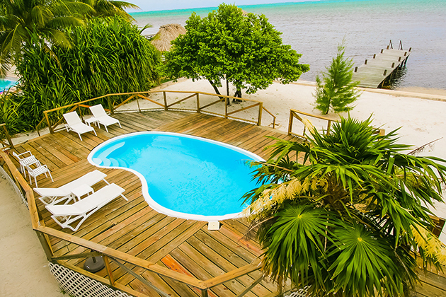 Promo-Tile-Pedro's-Caribbean-Escape-Pool-Ocean-Palm-Trees-Utopian