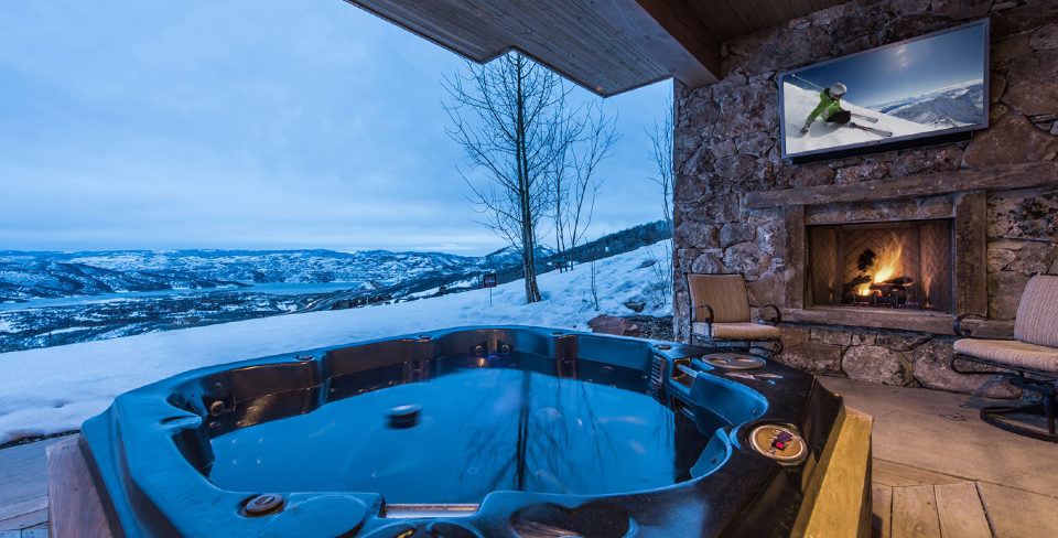 Covered hot tub in Park City with winter valley views