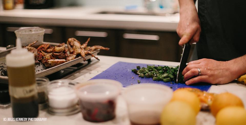 Private chef preparing dinner in gourmet kitchen