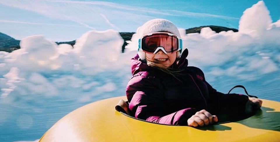Girl sledding in the winter