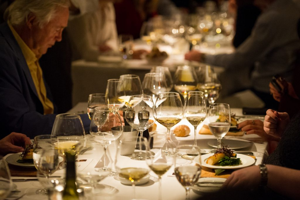 Diners enjoy food and wine at a previous Cornucopia event.