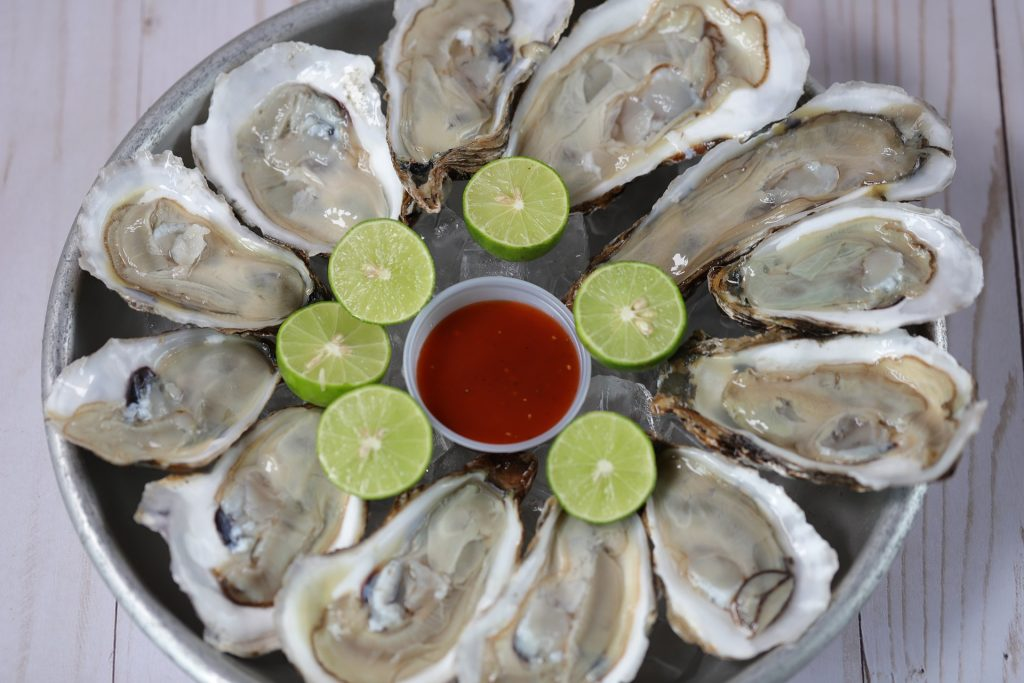 A plate of raw oysters.