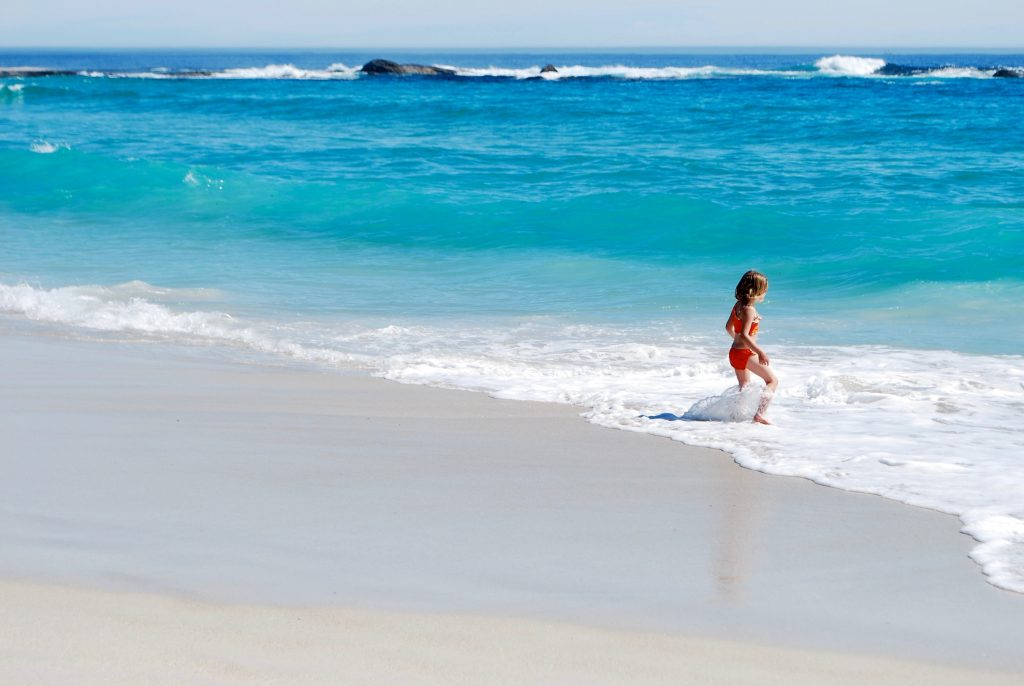 Girl walking into the water.