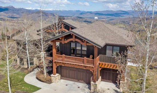 outside view of luxury park city rental eagle ridge home with mountains in background