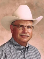 A man with a white cowboy hat and glasses.