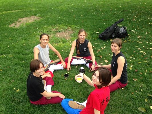 a group of young children sitting around a park. buy photo