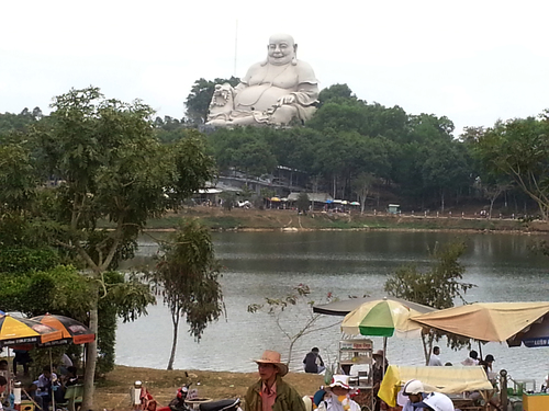Hilltop Buddha. trees, buddha, religion, lakes, statues, buddhism, vietnam, beliefs, hilltops, phuocthanh. buy photo