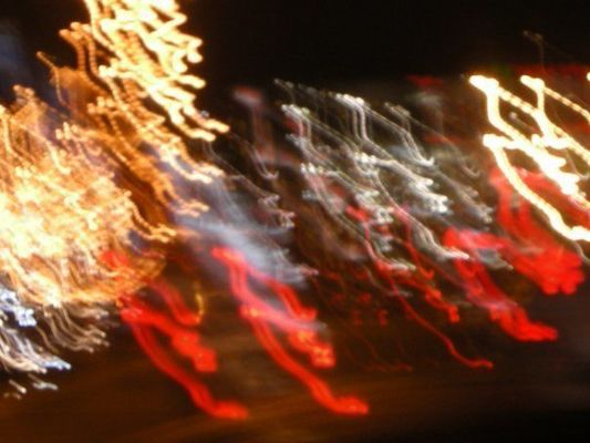 a close up of a traffic light in a city. buy photo