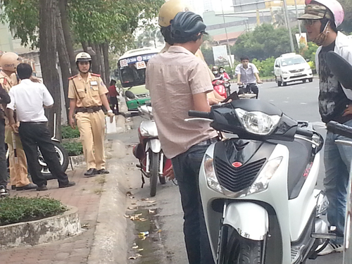 Busy cops. streets, buses, motorcycles, vietnam, uniforms, conversations, saigon, lawandorder, lawenforcement, helmets, trafficpolice, hcmchochiminh. buy photo