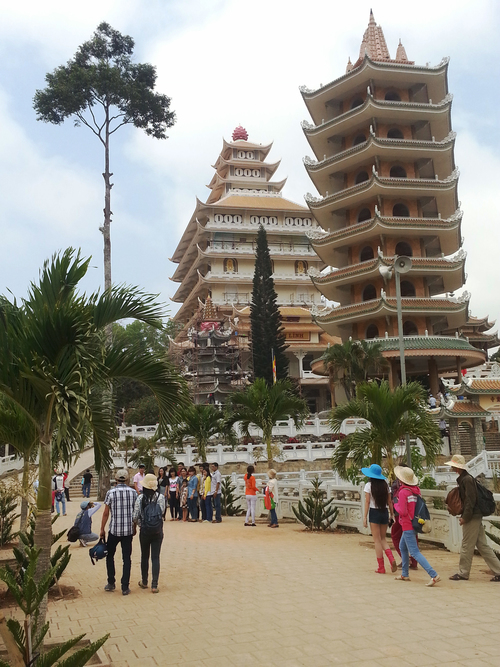 Popular pagoda. trees, vertical, architecture, religion, towers, couples, buddhism, tourists, vietnam, temples, pagodas, beliefs, trishngo, phuocthanh. buy photo