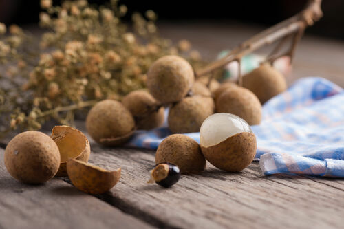 Longan. wood, summer, food, brown, white, plant, color, tree, nature, yellow, closeup, fruit, table, asian, thailand, juicy, healthy, asia, natural, market, sweet, eating, seasonal, group, seed, tasty, fresh, gourmet, delicious, exotic, health, pile, snack, thai, round, vegetarian, tropical, bunch, tropic, pulp, organic, diet, agriculture, sugary, nutrition, vitamin, longan, lungan. buy photo