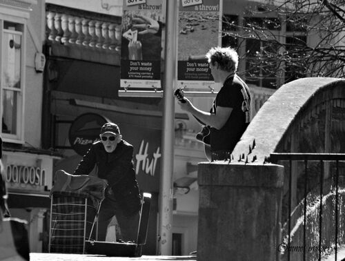 The old man and the busker. blackandwhite, mono, nikon, streetphotography, oldman, streetscene, streetperformer, busker, essex, chelmsford, sigma70300, d3100, ommot, ommotimagery. buy photo