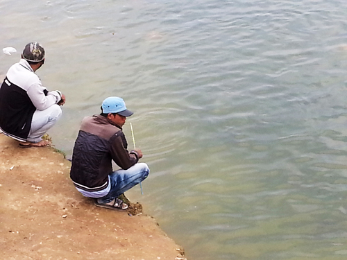 By the lake. friends, waiting, lakes, vietnam, mates, squatting, phuocthanh. buy photo