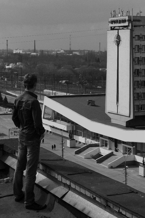 a man standing in front of a train station. buy photo