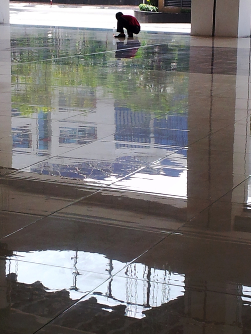 Polished effort. vertical, floors, reflections, workers, apartments, shine, cleaners, vietnam, tiles, saigonpearl, hcmchochiminh. buy photo