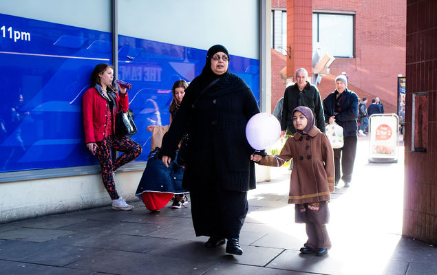 a group of people standing around a building. street, candid, leicester, manualfocus, pentaxk01, smcpentax28mmf35. buy photo