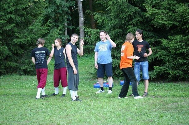 a group of people standing in a field with a frisbee. buy photo