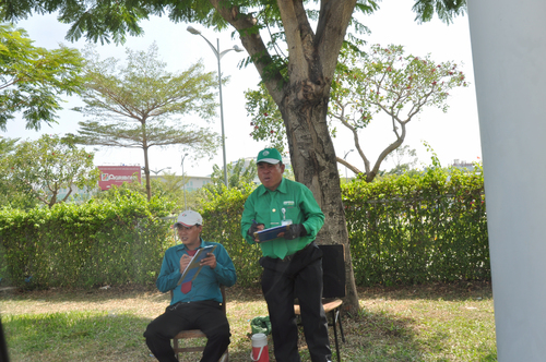 Counting cabs. workers, taxis, vietnam, uniforms, airports, cabs, saigon, checking, counting, hcmc, hochiminh, clipboards. buy photo