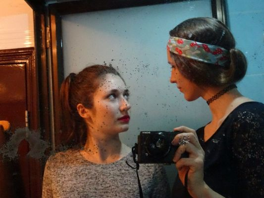 a woman is taking a picture of herself in the mirror. buy photo