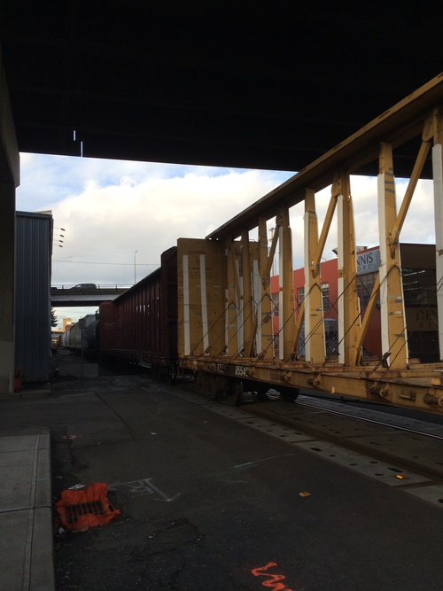 a train traveling down tracks next to a train station. buy photo