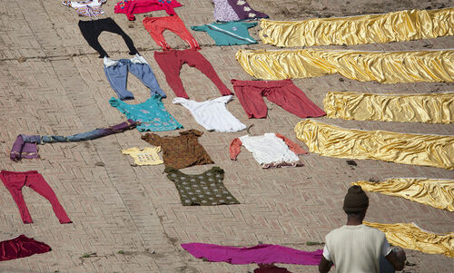Drying the clothes. woman, india, colours, clothes, varanasi, material, drying. buy photo