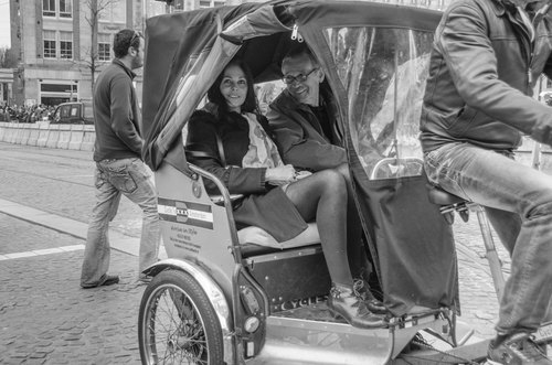 pedicab. street, city, portrait, people, woman, sexy, girl, smile, amsterdam, fashion, portraits, happy, outfit, women, legs, candid, style, streetlife, skirt, pantyhose, fiets, streetwear, mensen, streetfashion, streetportraits, streetstyle. buy photo
