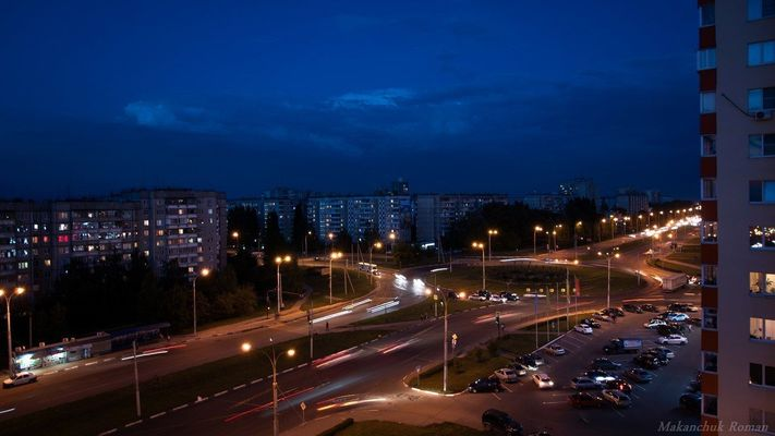 a city street at night with a traffic light. buy photo