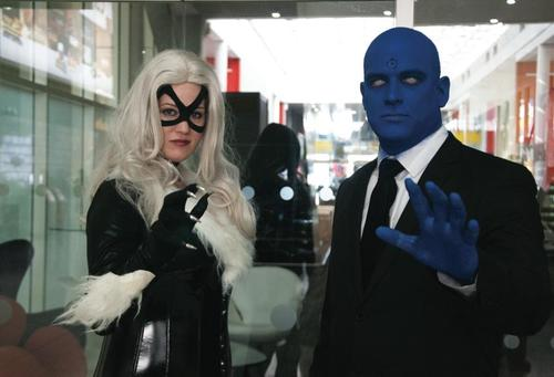 Black Cat Dr Manhattan cosplayers, London Super Comic Con, Excel, Docklands, London, 16th March 2014. people, comics, cosplay, marvel, watchmen, alanmoore. buy photo