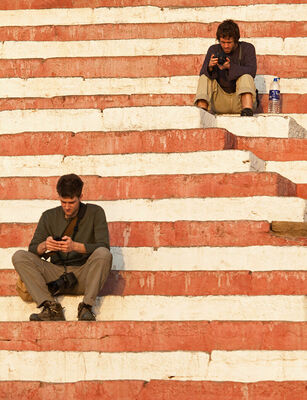 On the Ghat Steps. orange, india, men, steps, varanasi, resting, ghat. buy photo