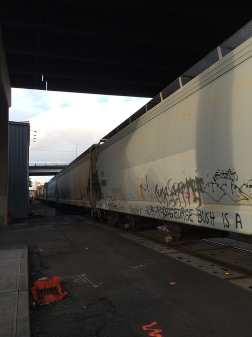 a train is parked on the side of a train. buy photo