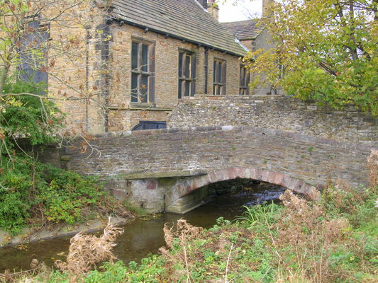 Old Pack Bridge at Wilderness Beck, Skipton. county, uk, england, building, history, stone, river, outside, crossing, place, photos, yorkshire, north, visit, tourist, times, wilderness, past, dales, skipton, relic, olden, yorks, packbridge, ©2014tonyworrall, photosofskipton. buy photo